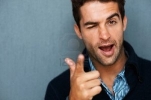 8368122-attractive-man-winking-and-pointing